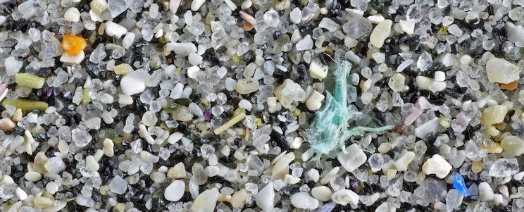Plastic pollution in sand on beach - Bo Eide
